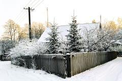 Winter rural landscape. House, tree , fence in winter rural landscape Stock Images