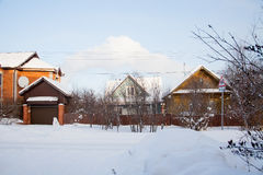 Winter rural landscape with private houses Royalty Free Stock Images