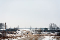 Winter rural landscape with a road Royalty Free Stock Photo