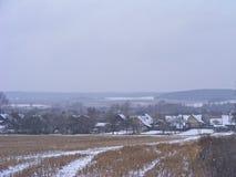 Winter rural landscape. Russian village. Farm field scene. Winter rural landscape. Russian village. Farm field stock image