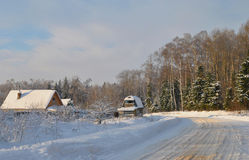 Winter rural landscape in the russian village on a sunny day Stock Photography