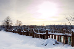Winter rural landscape and sunset Royalty Free Stock Photo