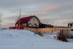 Winter rural landscape at sunset Royalty Free Stock Photo
