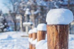 Winter rural landscape view through a wooden fence. Stock Photos