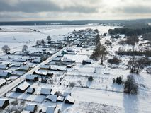 Winter rural landscape. Village coverd by snow. Aerial view. Winter rural landscape. Village, houses coverd by snow. Aerial view over private houses in Royalty Free Stock Image