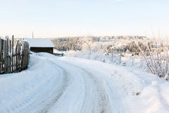 Winter rural road and trees in snow Stock Images