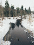 Winter rural scene with fog and frozen river- vintage effect Stock Photography