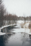 Winter rural scene with fog and frozen river- vintage effect Stock Image