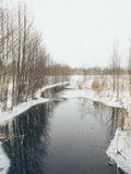 Winter rural scene with fog and frozen river- vintage effect Royalty Free Stock Photo