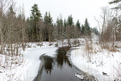 Winter rural scene with fog and frozen river Stock Image