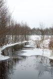 Winter rural scene with fog and frozen river Royalty Free Stock Photo
