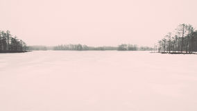 Winter rural scene with fog and white fields - retro vintage eff Stock Photos