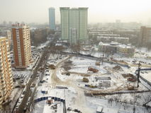 Winter in Russia. Severe snowfall in Moscow. Construction works in the snow during severe winter in Moscow Royalty Free Stock Images