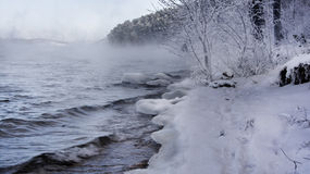 Winter Russian lake - water, mist, snow forest and mountains Royalty Free Stock Photography
