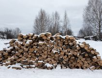 Winter Russian provincial landscape with firewoods.  royalty free stock photos