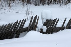 Winter Russian provincial landscape with old wooden fence.  royalty free stock photos