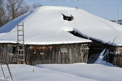 Winter in russian village Stock Photos