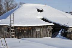 Winter in russian village Stock Photos