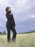 Winter's Child 01. Girl in black with fur hat standing in a field Royalty Free Stock Photo