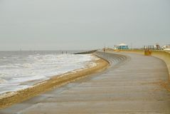 Winter`s day along Hunstanton`s south promenade. View along Hunstanton`s south promenade toward the launching slipway on a cold windy December day royalty free stock images
