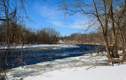 Winter`s day on the Farmington River. Winter landscape featuring the rapids in the Farmington River in Windsor, Connecticut Stock Photos