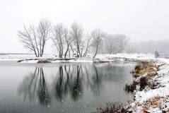 Winter's First Snow. Winter with it's first snow over a lake stock photography
