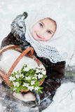Winter's Tale. Portrait of girl with snowdrops Stock Image