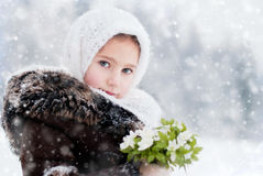 Winter's Tale. Portrait of girl with snowdrops Stock Images
