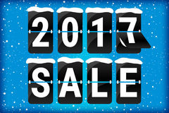 Winter sale 2017 analog flip text blue. Winter sale 2017 analog flip text with snow flakes on a blue background and snow on the flipping letters. Seasonal offer Stock Image