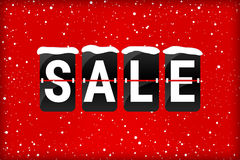 Winter sale analog flip text red. Winter sale analog flip text with snow flakes on a red background Stock Photo