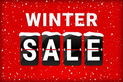 Winter sale analog flipping text red. Winter sale analog flip text with snow flakes on a red background and snow on the flipping letters Stock Photo