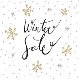 Winter sale background with handwritten text and doodle snowflakes,  Royalty Free Stock Photo