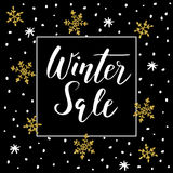 Winter sale background with handwritten text, golden doodle snowflakes and stars.  Stock Images