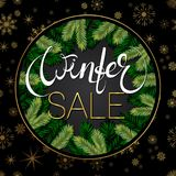 Winter sale background. Holiday composition with tree brabches, gold foil snowflakes. Vector Royalty Free Stock Image