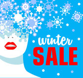 Winter sale. Banner. Fashion girl with snowflakes. Bold, minimal style.  Stock Image