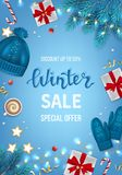 Winter sale banner, poster, flyer template with realistic gift boxes, hat, mittens, garlands, fir branches, sweets. On a blue background. Discount seasonal Royalty Free Stock Photos