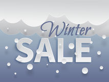 Winter sale banner template. With white snow and clouds, text with shadows on blue background. Vector illustration made in paper cut out style royalty free illustration