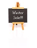 Winter Sale. Blackboard with text and easel. Stock Photography