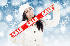 Winter sale on blue defocused lights Royalty Free Stock Image