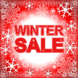 Winter Sale on a bright Background with Snowflakes. Royalty Free Stock Photo