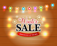 Winter Sale with Christmas Lights and snowflakes. Xmas Holiday Greeting Cards Design. Wooden Hand Drawn Background. Stock Image
