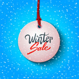 Winter sale handwritten text on label, advertising vector illustration Royalty Free Stock Image