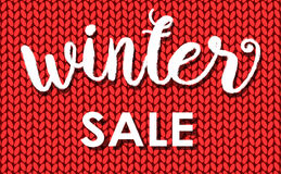 Winter sale. Ink painted inscription on red background from knitted wool. Vector illustration. Stock Photography