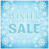 Winter sale inscription blue background with snowflakes Stock Photo