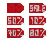 Winter sale knitted red and white tags. Text and numbers royalty free illustration