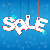 Winter Sale. Letters hanging on ropes with snowflakes royalty free illustration