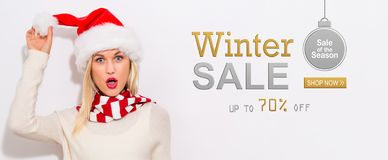 Winter sale message with woman with Santa hat. Winter sale message with happy young woman with Santa hat royalty free stock photo
