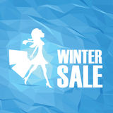 Winter sale poster template on modern blue white low poly vector background. Sexy fashion model woman with shopping bags Stock Photos