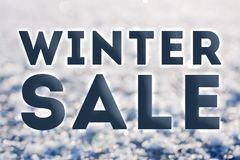 Winter sale ready advertisment. Bold letters on frozen snow background Stock Photos