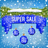 Winter sale ribbon decorated with blue Christmas balls, Christmas tree branches, snow and snowflakes on light blue background. Composition of winter sale ribbon Royalty Free Stock Photo